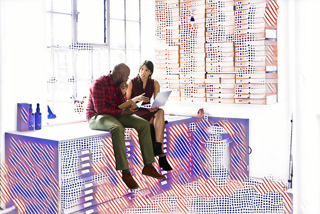 Two employees talking to each other surrounded by graphics representing data