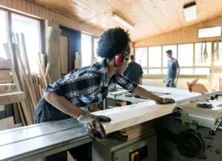 Woman operating a table saw on a jobsite