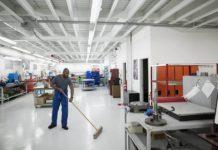 Man sweeping factory floor